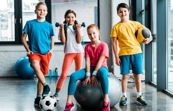 group of kids with sports equipment